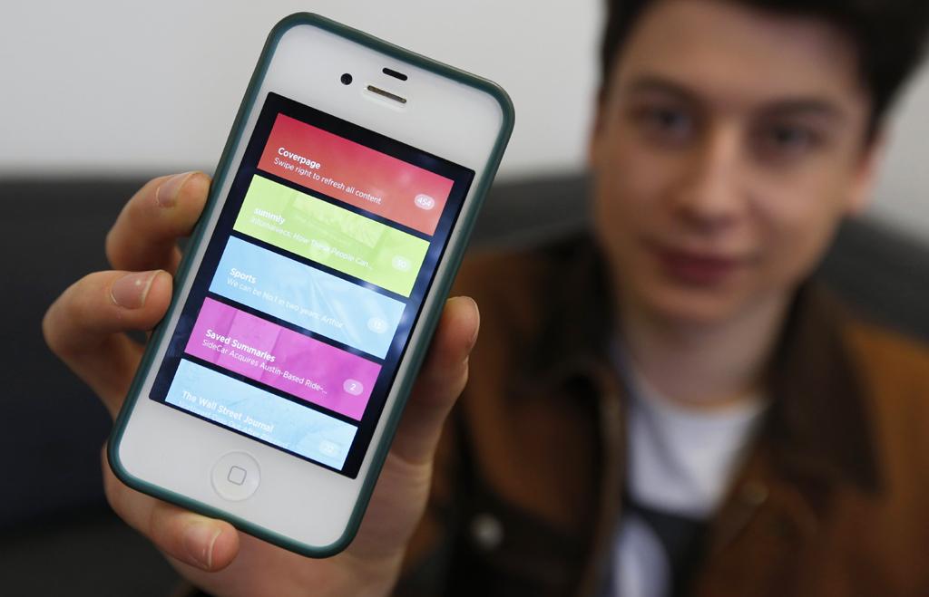 Nick exibe a aplicação que o tornou multimilionário